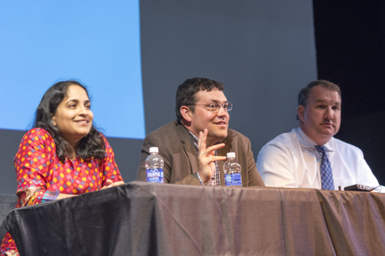 College of Medicine Clinical Assistant Professors Radha Nandagopal, Chris Davis and Henry Mroch preside over a panel discussion about careers in medicine at Spokane's West Valley High School on April 25, 2016.