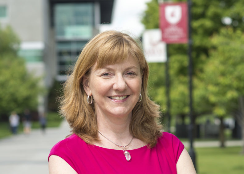 Photo of new ESFCOM Vice Dean for Student and Faculty Experiences Dawn DeWitt, pictured outside on the campus of WSU Spokane.