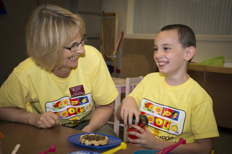 Speech and Hearing Sciences Associate Professor Nancy Potter works with one of the children attending this summer's Camp Candoo for children with apraxia on the WSU Spokane campus.