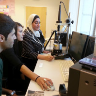 Dr. Nehal Abu-Lail works with students in her lab