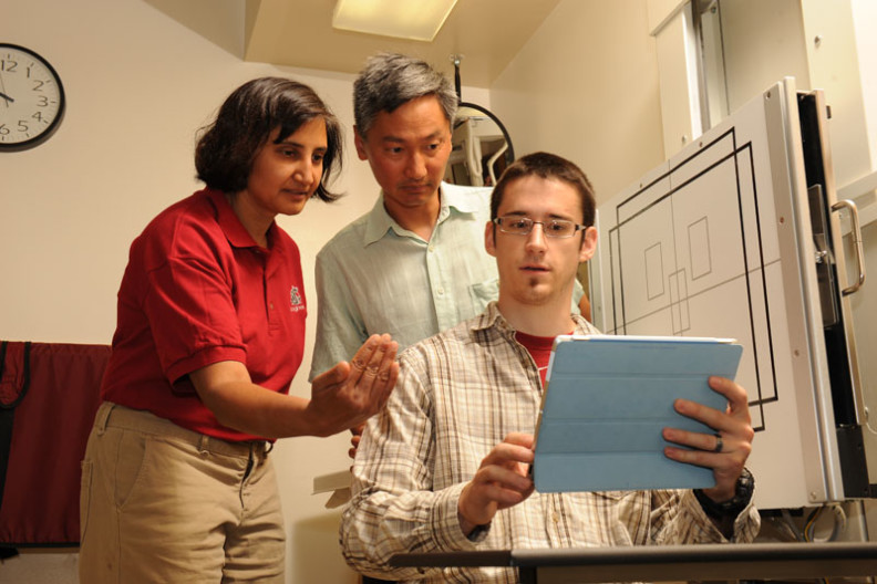 Dr. Anita Vasaveda and Dr. David Lin discuss tablet neck strain with graduate student