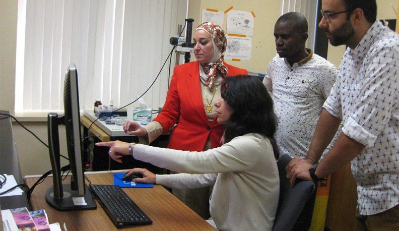 Dr. Nehal Abu-Lail with her graduate students, Somayeh Ramezanian, Samuel Uzoechi, and Baran Arslan