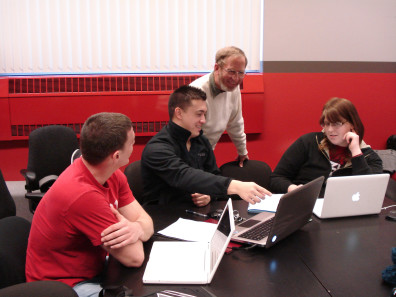 Professor Denny Davis working with students in the Capstone Design class