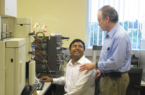 Professor Neil Ivory working with PhD student, Ashfaq Ansery, in the lab