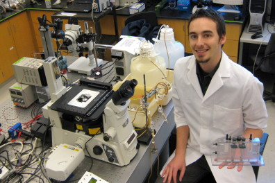 Ryan Renslow in the lab with biofilm reactor