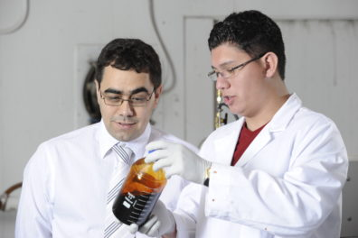 Dr. Garcia-Perez works with a student in the lab