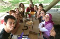 WSU REU Program students and Dr. Abu-Lail sitting at picnic table