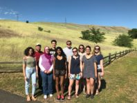 WSU REU Program students and Dr. Abu-Lail standing outside in front of the Palouse hills
