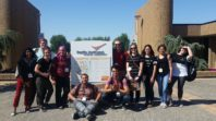 WSU REU Program students pose with PNNL sign in Richland, WA