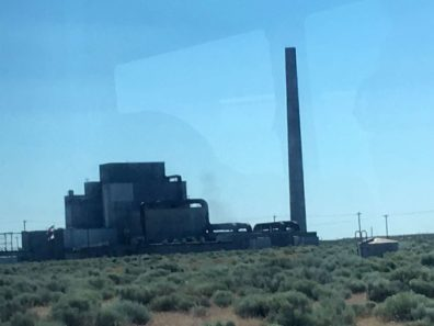 Hanford Nuclear Site with smoke stack surrounded by sage brush