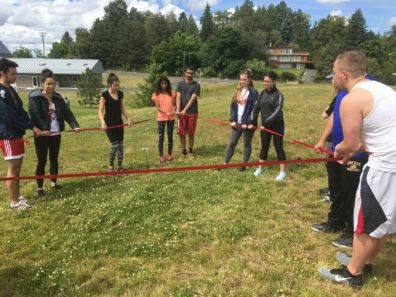 Chemical engineering students holding rope during WSU REU Program Rec challenge