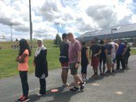 Chemical engineering students standing in line for WSU REU Program Rec challenge