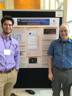 Gabriel Ng and Dr. Neil Ivory with poster presentation