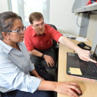 Afshin Khan and Kevin Gray working at the computer