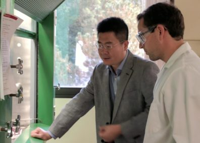 Dr. Hongfei Lin discussing research with one of his team