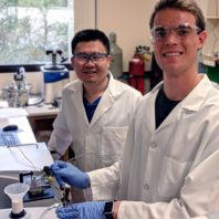 Kristian Gubsch and Dr. Hongfei Lin working in the lab