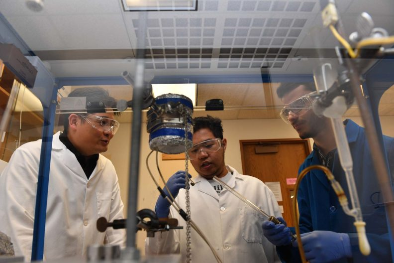Su Ha and his students working in the lab