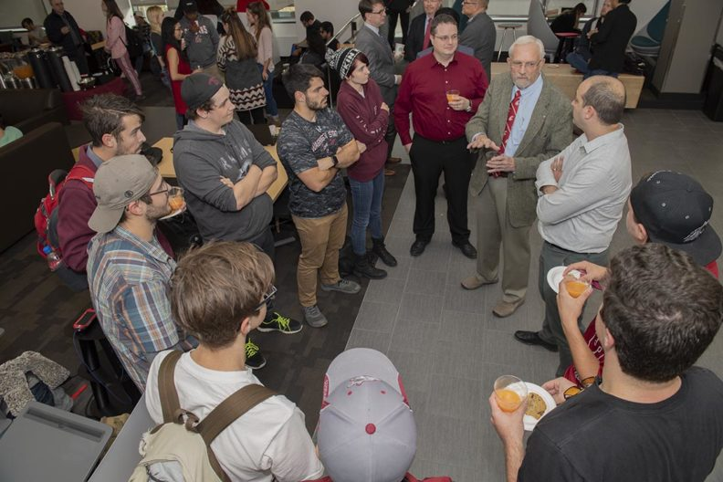 David Ensor speaking with a group of students, faculty and staff.