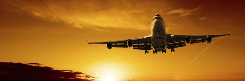 jumbo jet landing at dusk, panoramic frame