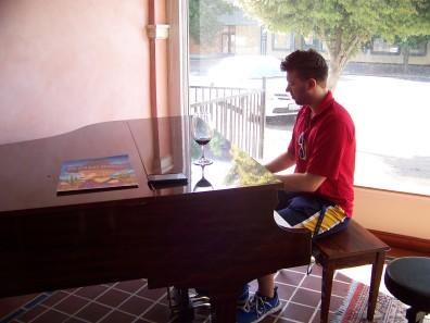 Ben playing the piano at Morrison Lane