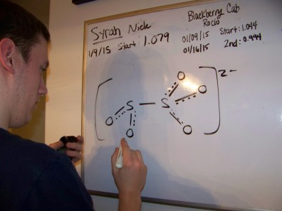 Nick drawing out potassium metabisulfite (the sanitizer in wine production).
