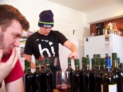 Nick is heat shrinking his caps on the top of his wine bottles.