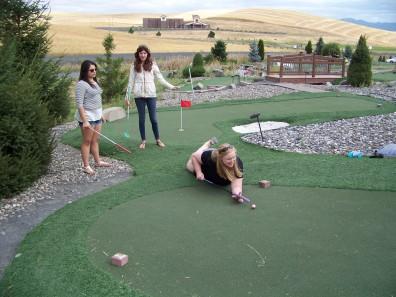 Paige on hole 5 (use club as pool cue)