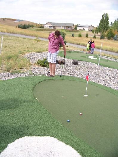 Ben on hole 8 (hold club backwards)
