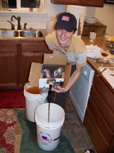 Adding the grape juice to the primary fermenter