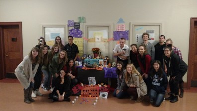 Instructor Diaz-Gomez's Spanish 102 class and the altar they created for Dia de los Muertos.