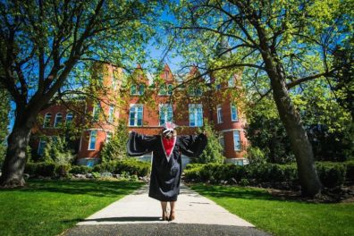 One of Tiffani's graduation pictures featuring Thompson Hall.