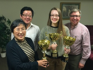 From left to right, Xiaotong Lin, Weiguo Cao, Trudy Boothman and Christopher Lupke with Trudy's trophies.