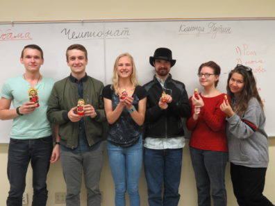 Students holding Russian nesting dolls