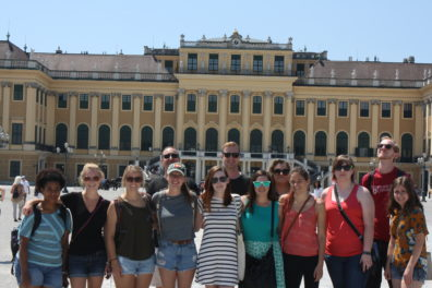 Dr. Hughes with students in front of Schönbrunn castle in Vienna