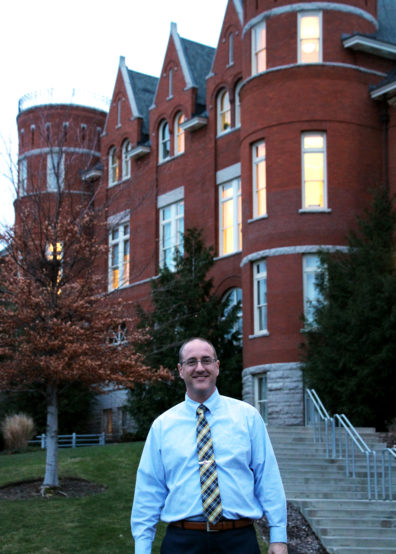 DFLC Chair JT in front of Thompson Hall