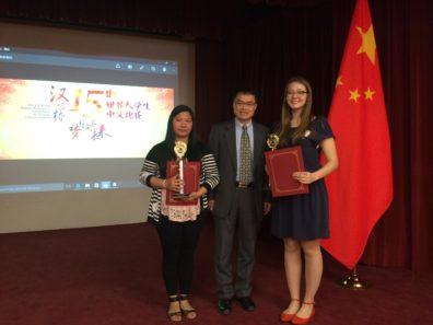 The two Washington competitors (from WSU and CWU) with the head of the Confucius Institute for Washington State, Mr. Zhou.