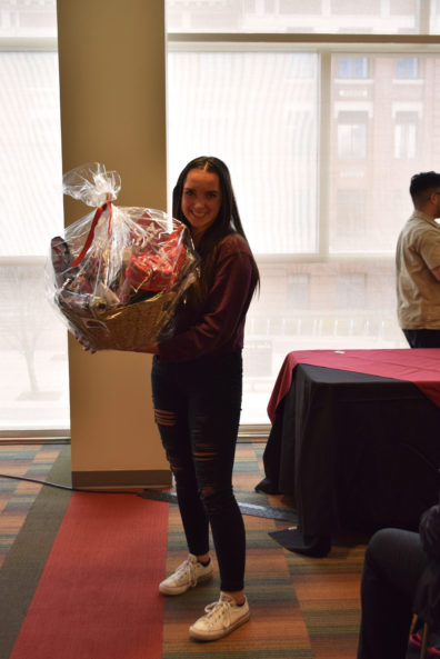 The visiting high school student who won our Coug-fan starter basket looks happy.
