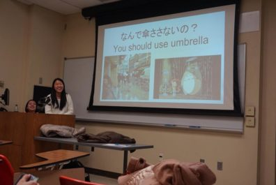 Japanese students present slide on being prepared for USA weather.