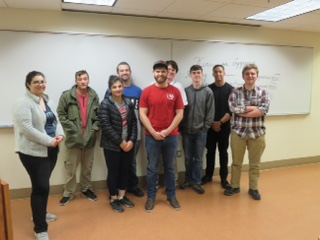 Russian 204 students standing at the front of class after presenting skit.