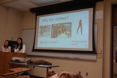 Japanese students present slide on clothing choices in USA.