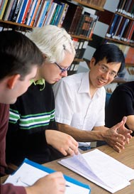 Raymond Sun with students