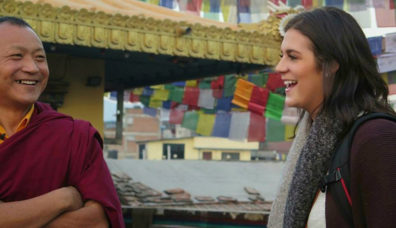 Student talking to Nepalese monk