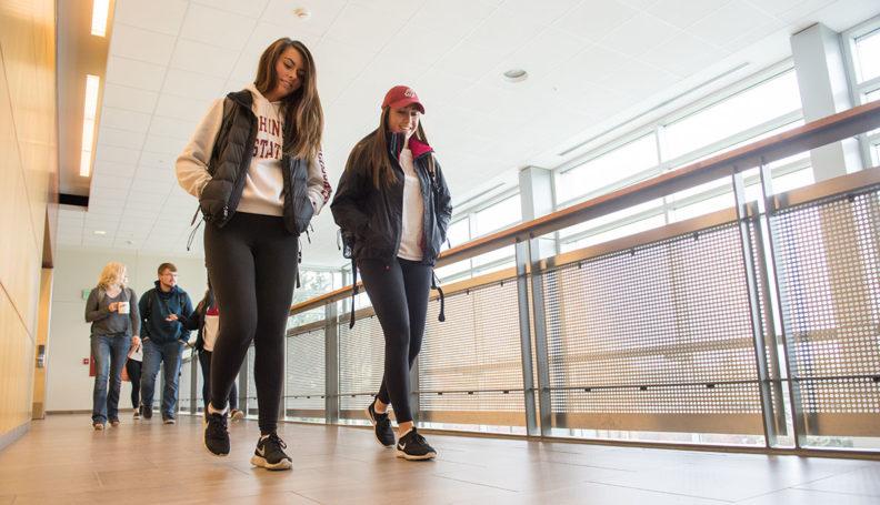 Students walking in the hall in Goertzen Hall