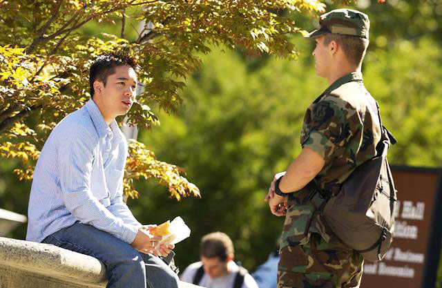 Student talking to soldier