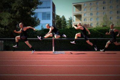 CJ Allen running hurdles