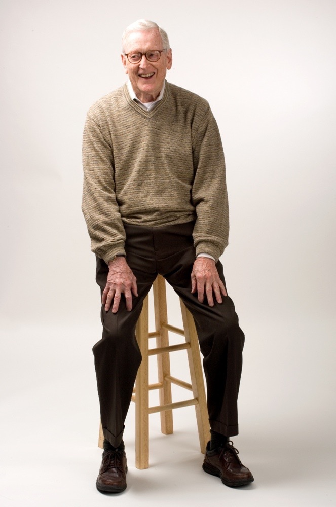 Jay Rockey Sitting on Stool