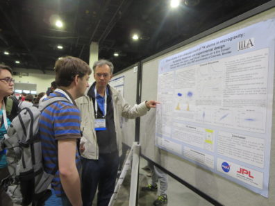 PI Dr. Peter Engels explaining Efimov physics to a curious passer-by at the poster session.