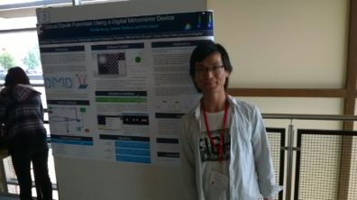 Graduate student Chunde Huang standing at his poster at the 2016 NWAPS meeting.