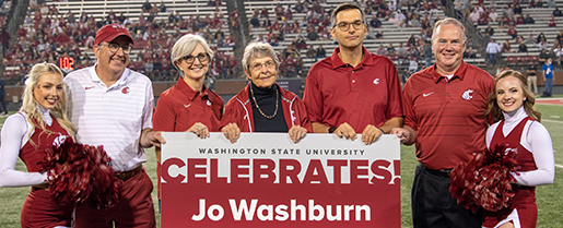 WSU and COE personnel pose for photo during a football game