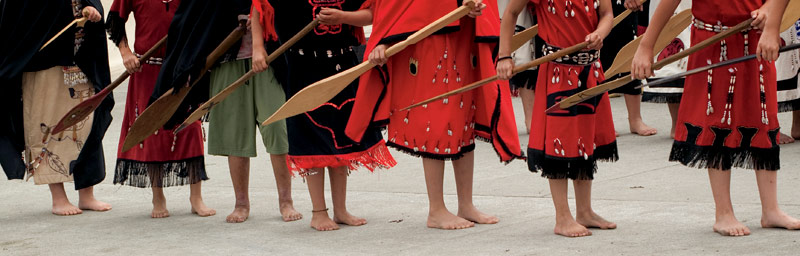 Young Makahs perform a traditional paddle dance at Makah Days in Neah Bay.